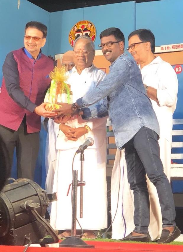 Mr.Kathiravan honoring Dr. Mohan Raj with Mr. Nalli Kuppuswami Chetti